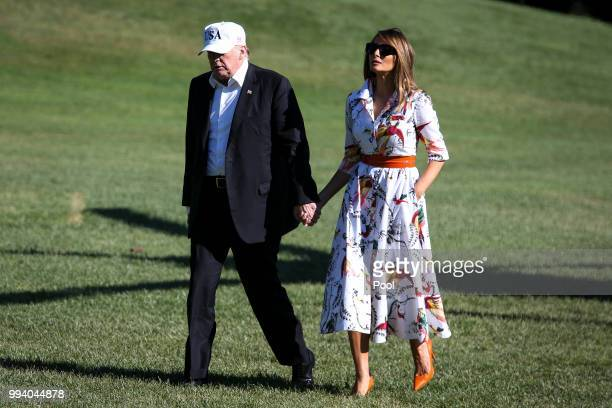 President Donald Trump and first lady Melania Trump cross the South Lawn upon arrival at the White House on July 8 2018 in Washington DC The First...