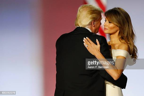 President Donald Trump and first lady Melania Trump dance at the Freedom Inaugural Ball at the Washington Convention Center January 20 2017 in...
