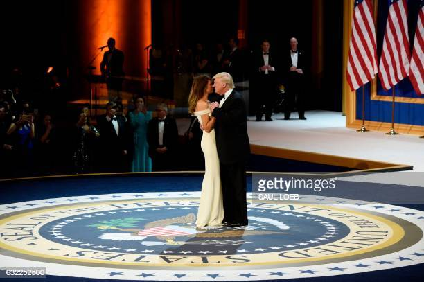 President Donald Trump and First Lady Melania Trump dance on the US President seal during the Salute to Our Armed Services Inaugural Ball at the...