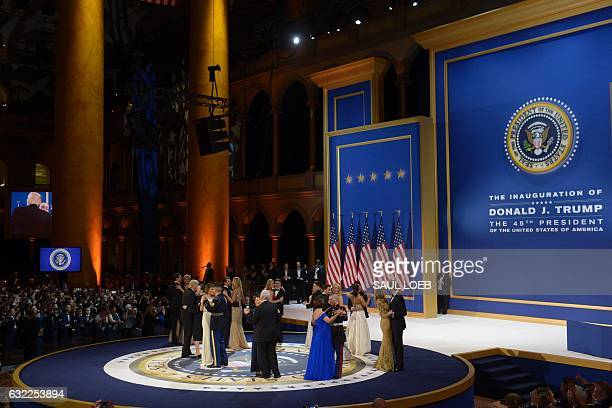 President Donald Trump and First Lady Melania Trump dance with members of the Armed Forces during the Salute to Our Armed Services Inaugural Ball at...