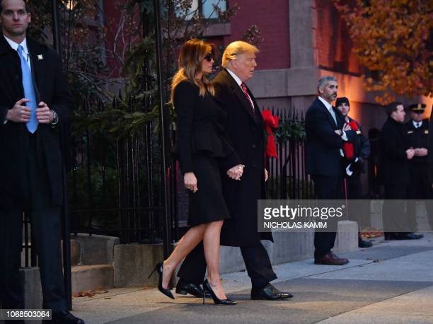 US President Donald Trump and first lady Melania Trump depart Blair House opposite the presidential mansion after visting former US President George...