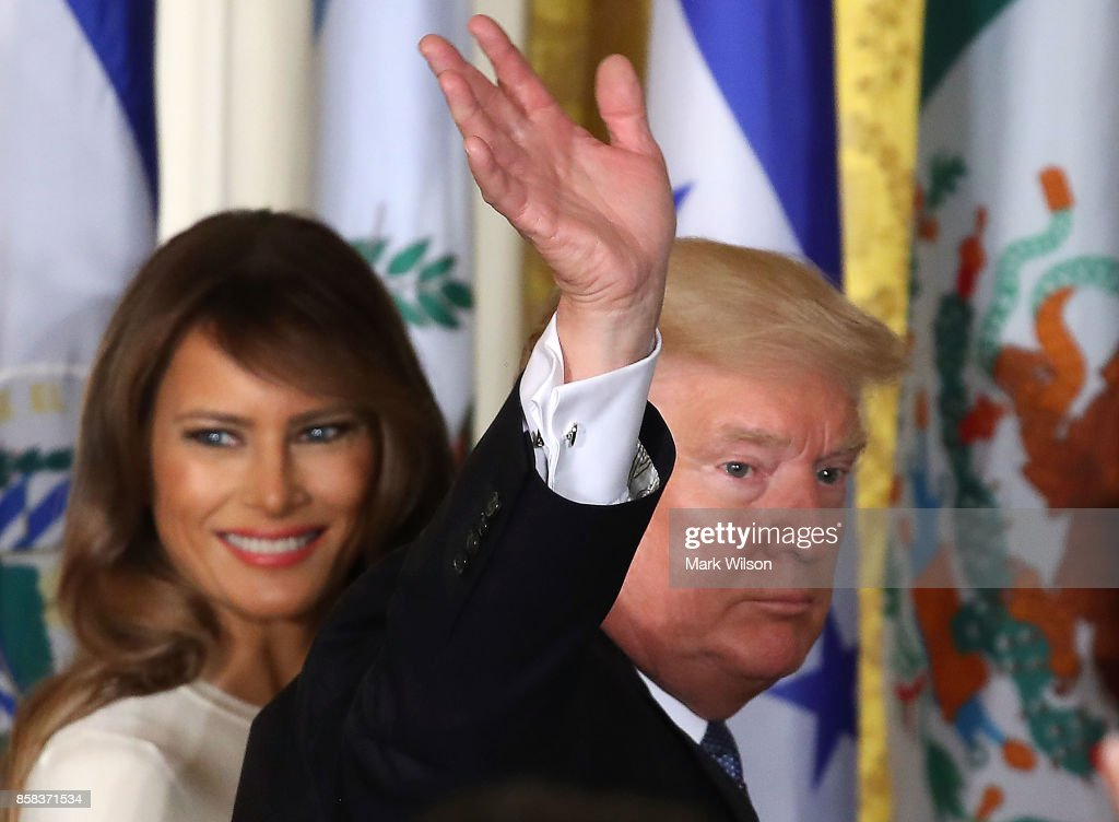 U.S. President Donald Trump and first lady Melania Trump depart from an event to celebrate Hispanic Heritage Month in the East Room at the White House, on October 6, 2017 in Washington, DC.