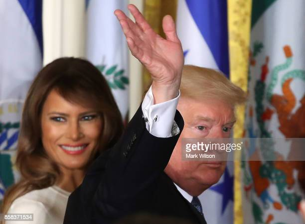 S President Donald Trump and first lady Melania Trump depart from an event to celebrate Hispanic Heritage Month in the East Room at the White House...