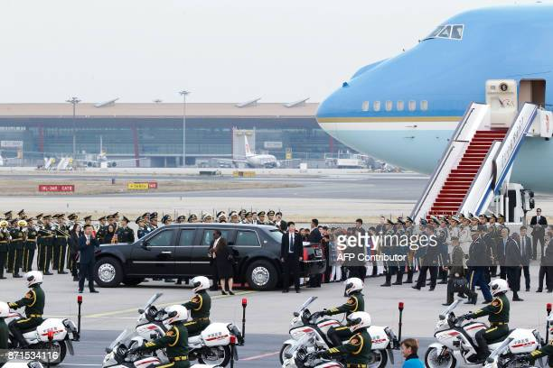 US President Donald Trump and First Lady Melania Trump depart from the tarmac after their arrival at Beijing airport on November 8 2017 US President...