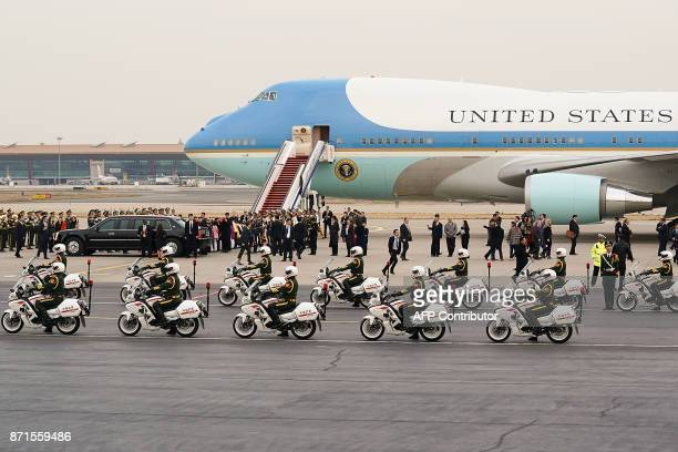 US President Donald Trump and First Lady Melania Trump depart from the tarmac after their arrival at Beijing Capital Airport on November 8 2017 US...