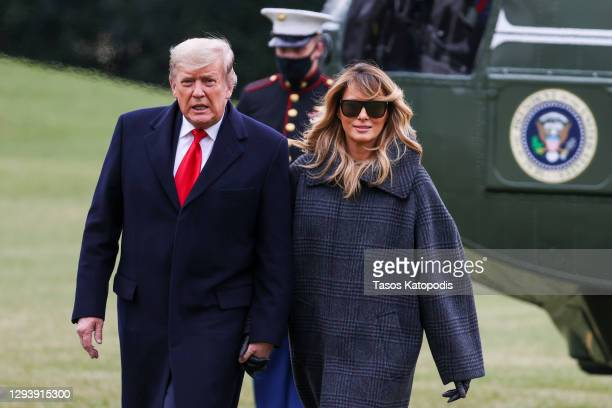 President Donald Trump and First Lady Melania Trump depart Marine One on the South Lawn of the White House on December 31, 2020 in Washington, DC....