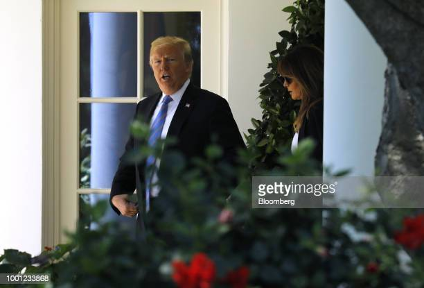 US President Donald Trump and First Lady Melania Trump disembark Marine One while arriving at Joint Airforce Base Andrews Maryland US on Wednesday...
