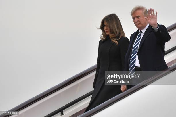 US President Donald Trump and First Lady Melania Trump descend from Air Force One after arriving in Beijing on November 8 2017 US President Donald...