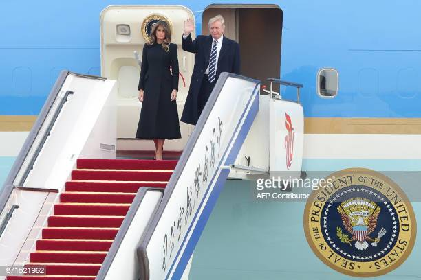 US President Donald Trump and First Lady Melania Trump descend from Air Force One as they arrive in Beijing on November 8 2017 US President Donald...
