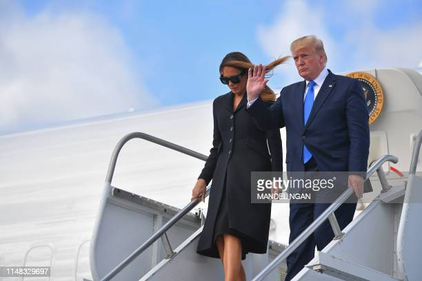 US President Donald Trump and First Lady Melania Trump disembark Air Force One upon arrival at Shannon Airport in Shannon County Clare Ireland on...
