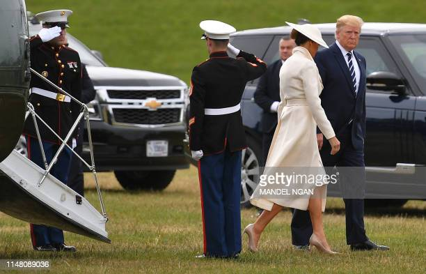 US President Donald Trump and First Lady Melania Trump disembark from the Marine One helicopter after arriving at Southsea Castle ahead of an event...