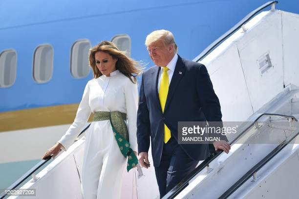 President Donald Trump and First Lady Melania Trump disembark from Air Force One at Sardar Vallabhbhai Patel International Airport in Ahmedabad on...