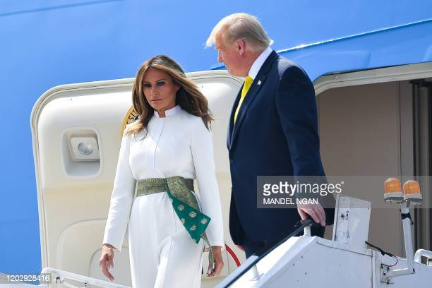 US President Donald Trump and First Lady Melania Trump disembark from Air Force One at Sardar Vallabhbhai Patel International Airport in Ahmedabad on...
