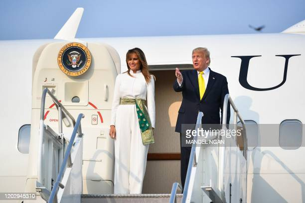 US President Donald Trump and First Lady Melania Trump disembark from Air Force One upon their arrival at Agra Air Base in Agra on February 24 2020
