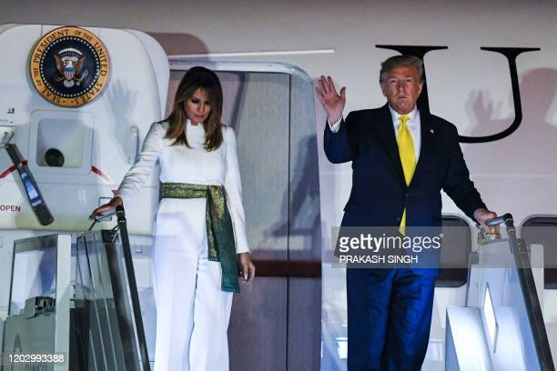 US President Donald Trump and First Lady Melania Trump disembark from Air Force One at Palam Air Force Base in New Delhi on February 24 2020