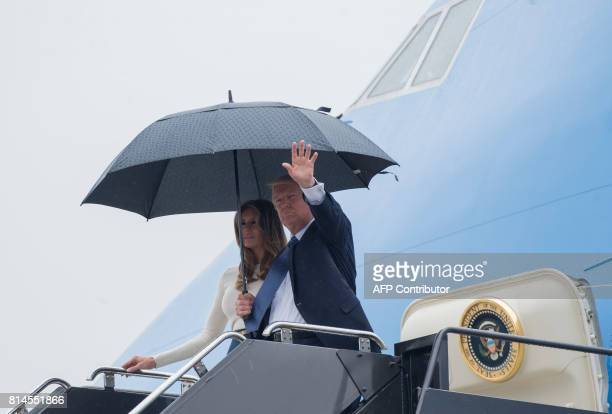 US President Donald Trump and First Lady Melania Trump disembark from Air Force One upon arrival at Newark Liberty International Airport in Newark...