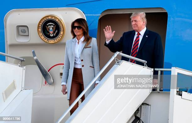 US President Donald Trump and First Lady Melania Trump disembark from Air Force One upon arrival at HelsinkiVantaa Airport in Helsinki on July 15...