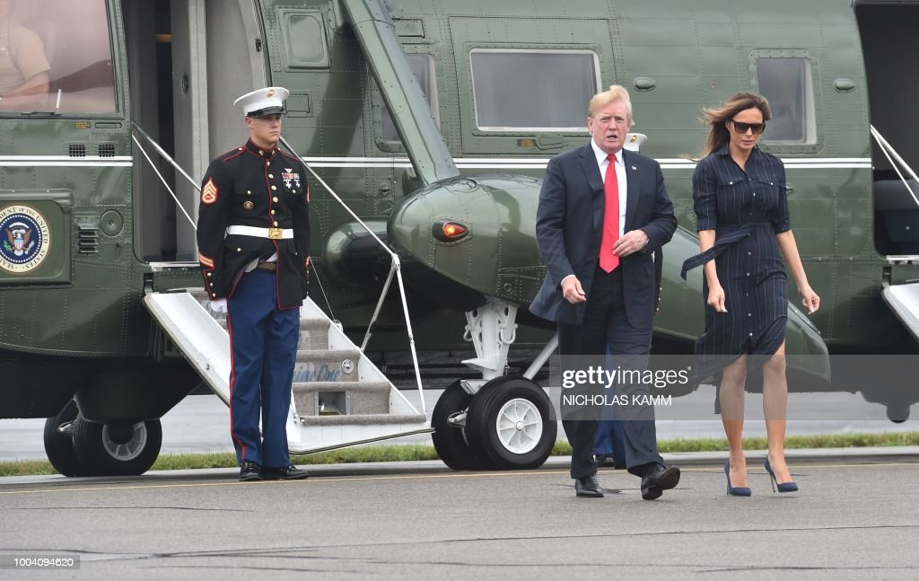US President Donald Trump and first lady Melania Trump disembark the Marine One helicopter prior to boarding Air Force One at Morristown Airport in Morristown, New Jersey, on July 22, 2018. - Trump is returning to the White House in Washington after spending the weekend at Trump National Golf Club in Bedminster, New Jersey.