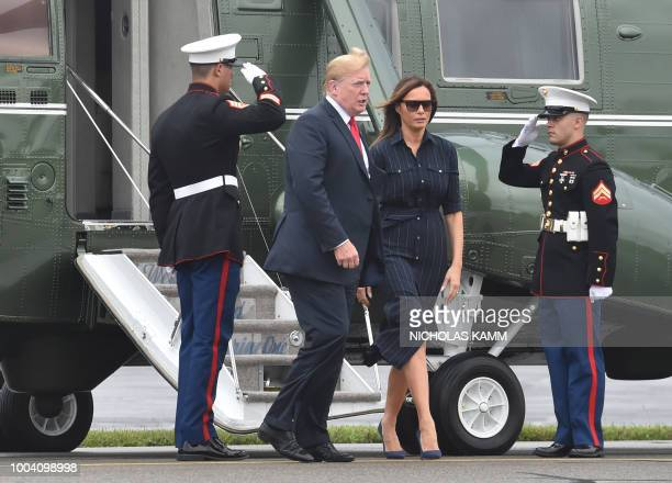 US President Donald Trump and first lady Melania Trump disembark the Marine One helicopter prior to boarding Air Force One at Morristown Airport in...