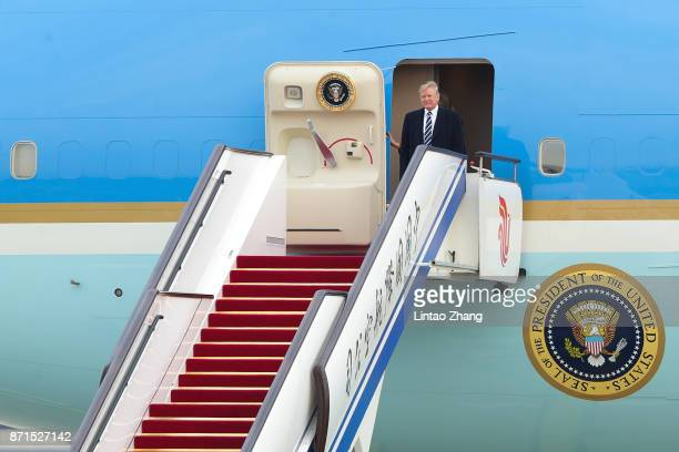 President Donald Trump and first lady Melania Trump exit Air Force One upon their arrival at Beijing Capital Airport on November 8 2017 in Beijing...