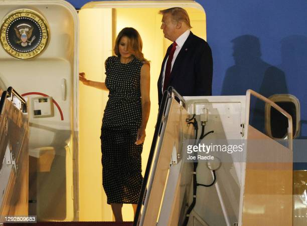 President Donald Trump and First Lady Melania Trump exit from Air Force One at the Palm Beach International Airport on December 23, 2020 in West Palm...