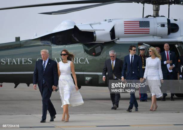 US President Donald Trump and First Lady Melania Trump followed by White House senior advisor Jared Kushner and Ivanka Trump make their way to board...