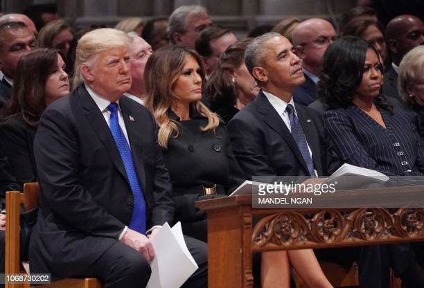 US President Donald Trump and First Lady Melania Trump former US President Barack Obama and First Lady Michelle Obama attend the state funeral of...
