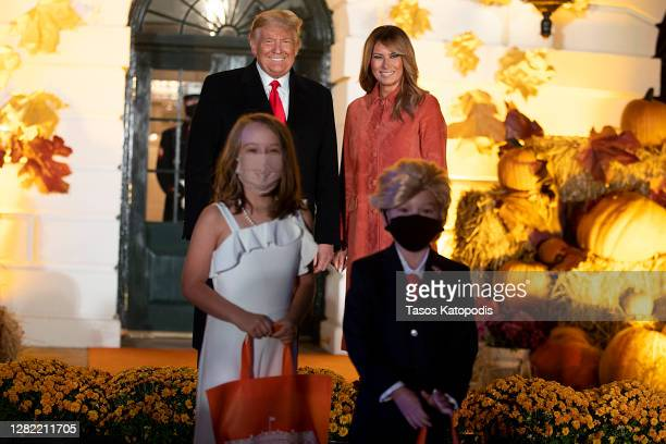 President Donald Trump and First Lady Melania Trump great guests on the south lawn of the White House on October 25, 2020 in Washington, DC. To...