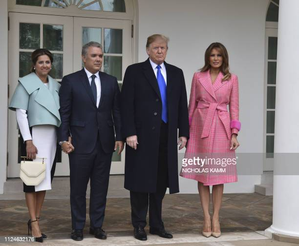 US President Donald Trump and First Lady Melania Trump greet Colombian President Ivan Duque and his wife Maria Ruiz at the White House in Washington...