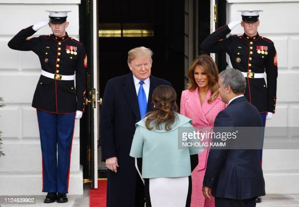 US President Donald Trump and First Lady Melania Trump greet Colombian President Ivan Duque and his wife Maria Ruiz to the White House in Washington...