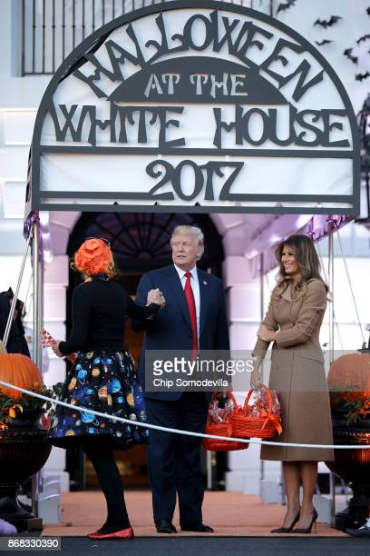 S President Donald Trump and first lady Melania Trump greet Education Secretary Betsy DeVos who was dressed as Ms Frizzle from 'The Magic Schoolbus'...