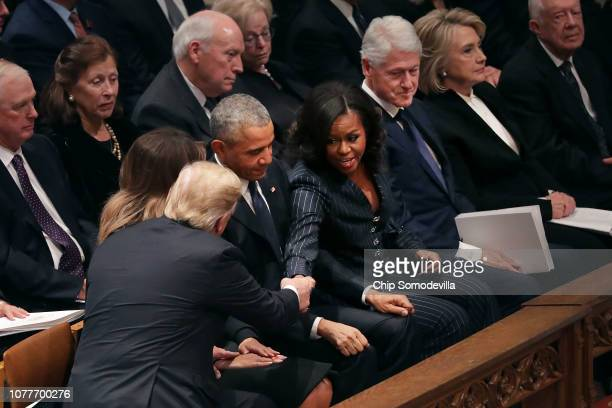 President Donald Trump and first lady Melania Trump greet former President Barack Obama and Michelle Obama as they join other former presidents and...