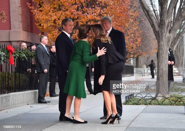 US President Donald Trump and first lady Melania Trump greet former US President George W Bush and his wife former first lady Laura Bush at Blair...
