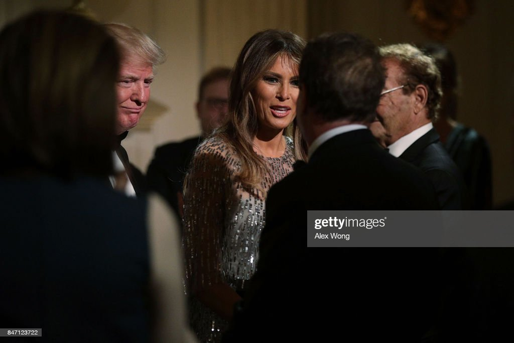 U.S. President Donald Trump and first lady Melania Trump greet guests during a reception at the State Dining Room of the White House September 14, 2017 in Washington, DC. President Trump and the first lady hosted a reception for the White House Historical Association.