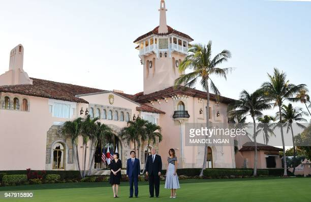 US President Donald Trump and First Lady Melania Trump greet Japan's Prime Minister Shinzo Abe and wife Akie Abe pose for a phot as they arrive for...