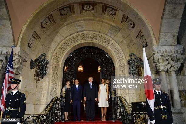 US President Donald Trump and First Lady Melania Trump greet Japan's Prime Minister Shinzo Abe and his wife Akie Abe ahead of a dinner at Trump's...