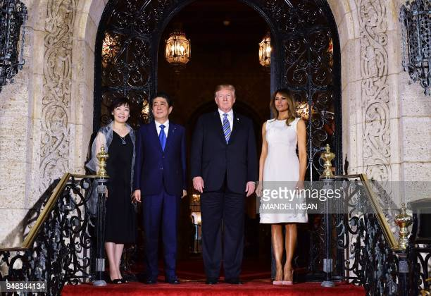 President Donald Trump and First Lady Melania Trump greet Japan's Prime Minister Shinzo Abe and his wife Akie Abe ahead of a dinner at Trump's...