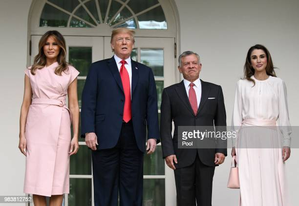 US President Donald Trump and first lady Melania Trump greet King Abdullah II and Queen Rania of Jordan on their arrival at the South Portico of the...
