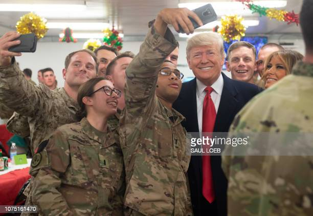 US President Donald Trump and First Lady Melania Trump greet members of the US military during an unannounced trip to Al Asad Air Base in Iraq on...
