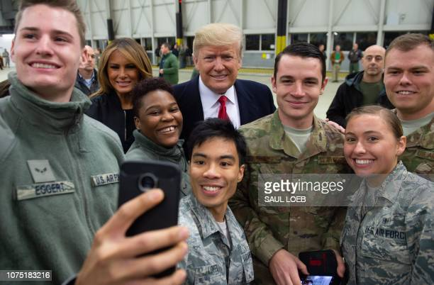 US President Donald Trump and First Lady Melania Trump greet members of the US military during a stop at Ramstein Air Base in Germany on December 27...