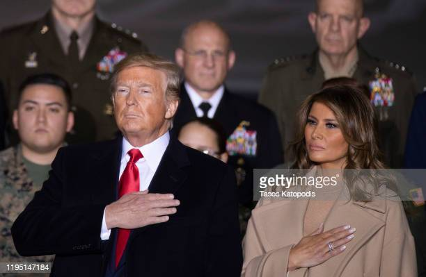 President Donald Trump and First Lady Melania Trump greet troops at the signing ceremony for S.1709, The National Defense Authorization Act for...