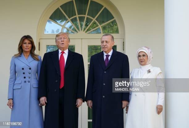 US President Donald Trump and First Lady Melania Trump greet Turkey's President Recep Tayyip Erdoan and his wife Emine Erdoan outside the White House...