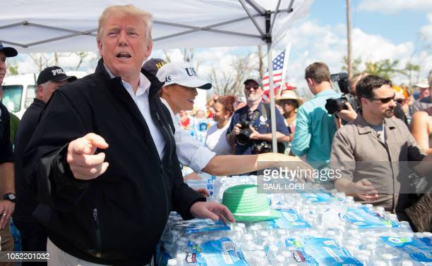 US President Donald Trump and First Lady Melania Trump hand out bottles of water as they tour damage from Hurricane Michael in Lynn Haven Florida...