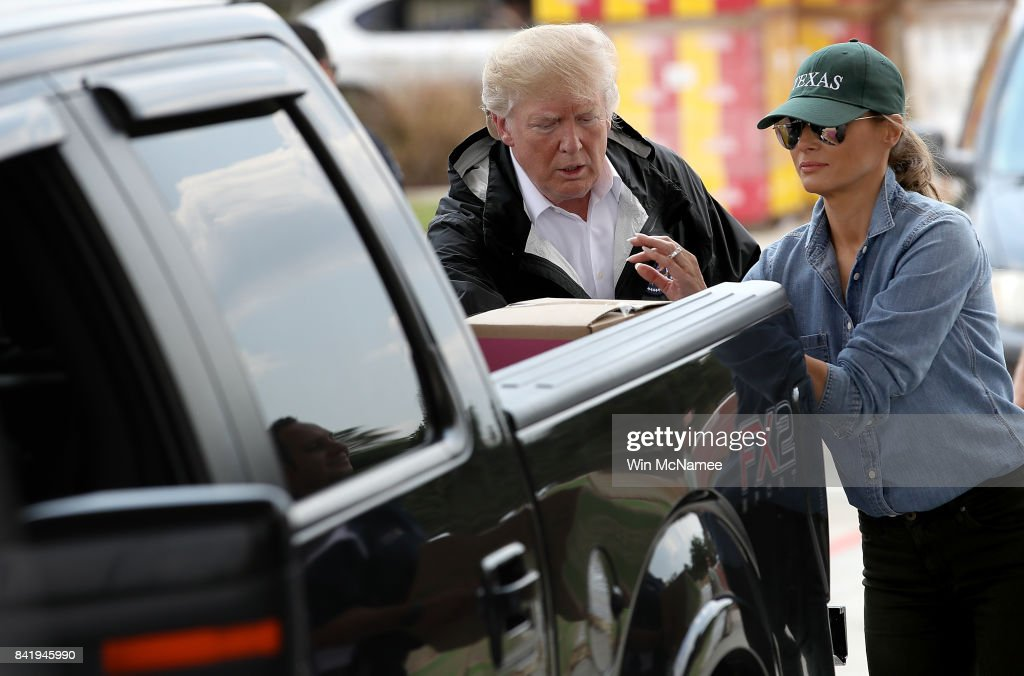 U.S. President Donald Trump and first lady Melania Trump hand out emergency supplies to residents impacted by Hurricane Harvey while visiting the First Church of Pearland September 2, 2017 in Pearland, Texas. Pearland, just south of Houston, was heavily damaged by the floodwaters created by the hurricane.