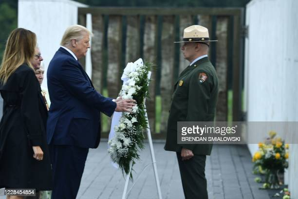 US President Donald Trump and First Lady Melania Trump lay a wreath during a ceremony commemorating the 19th anniversary of the 9/11 attacks in...