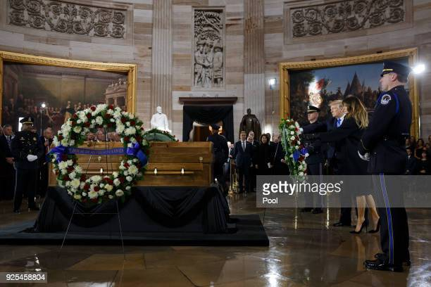 President Donald Trump and first lady Melania Trump lay a wreath during a ceremony as the late evangelist Billy Graham lies in repose at the US...