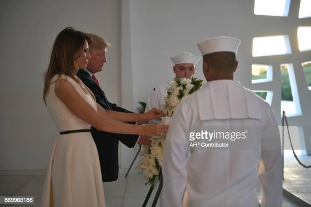 US President Donald Trump and First Lady Melania Trump lay a wreath at the USS Arizona Memorial on November 3 at Pearl Harbor in Honolulu Hawaii /...