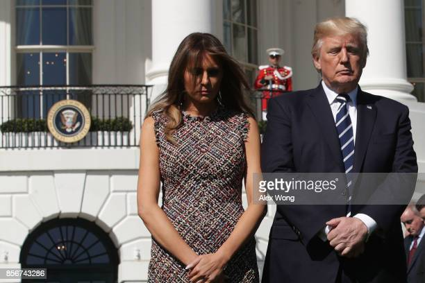 S President Donald Trump and first lady Melania Trump lead a moment of silence for the victims of the Las Vegas shooting October 2 2017 at the South...