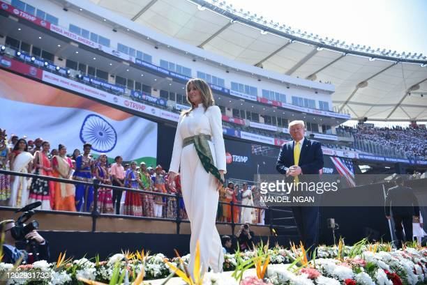 US President Donald Trump and First Lady Melania Trump leave after attending 'Namaste Trump' rally at Sardar Patel Stadium in Motera on the outskirts...