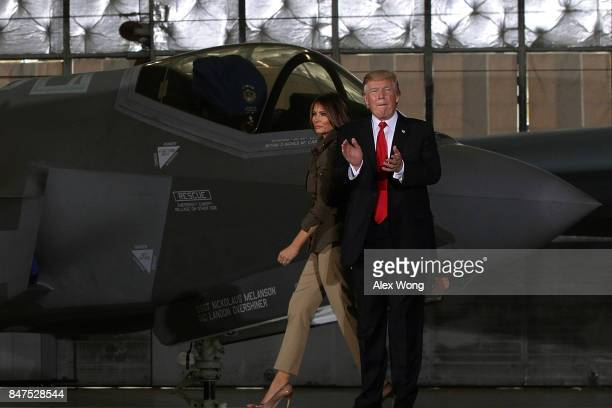 S President Donald Trump and first lady Melania Trump leave as they walk in front of an F35 fighter jet after he spoke to Air Force personnel during...
